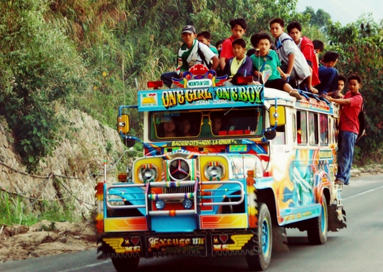 Jeepney, a common form of public transportation (packed as usual)