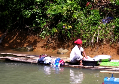 Woman washing clothes in the river